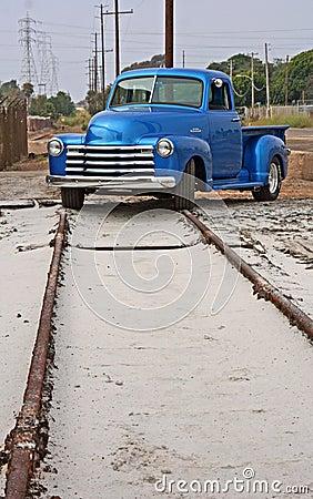 Telephone poles, train track, truck