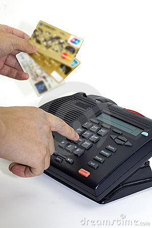 Telephone receiver and credit card Editorial Stock Photo