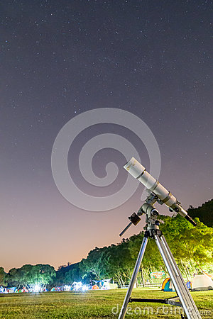 Telescope in Campsite and Starry Sky