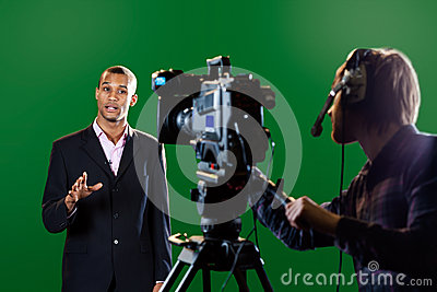 Presenter in studio with TV camera and Camera Oper
