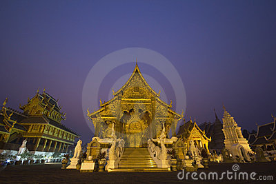 Temple at night with purple sky of Thailand
