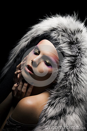 Tempting woman in coat with silver fox fur collar