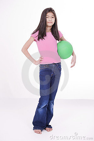 Ten year old girl holding green ball