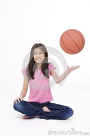 Ten year old girl throwing basketball