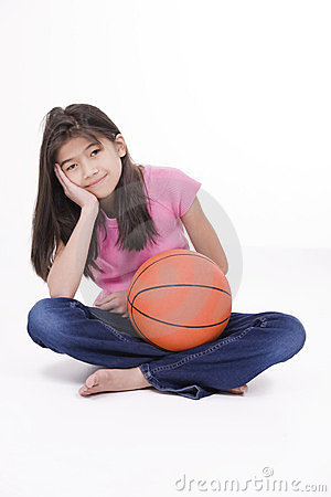 Ten year oldgirl holding basketball