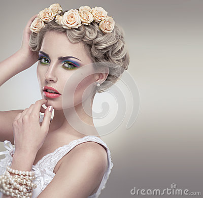 Tender beauty portrait of bride with roses wreath
