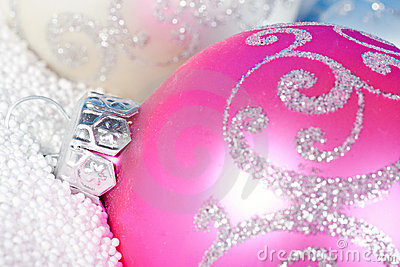 Tender Christmas bauble on to snow.
