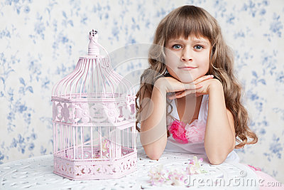 Tender dreamy romantic girl near open birdcage