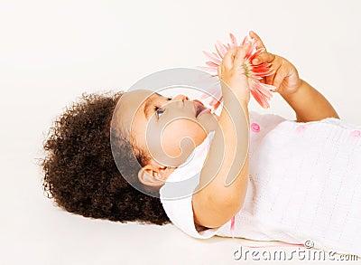 Tender little girl with a flower