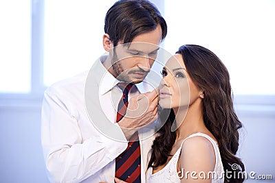 Tender man stroking his wifes cheek