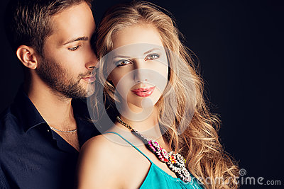 ... -young-couple-love-posing-studio-over-dark-background-35581321.jpg