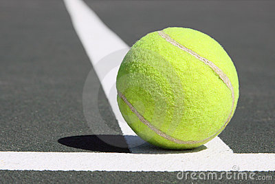 Tenis ball on white line
