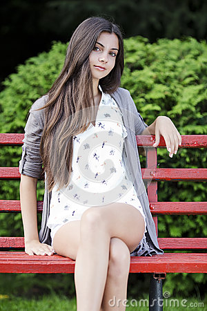 Tenn girl  sitting on bench