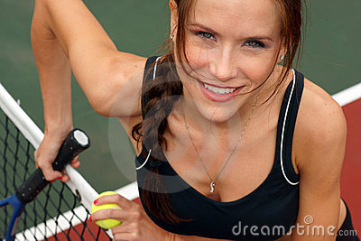 Beautiful Tennis Player Female at Court Net
