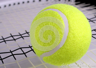 Tennis bal on racket