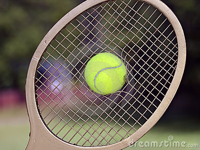 Tennis Ball Breaks Through Racquet Strings