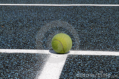 Tennis ball on court line