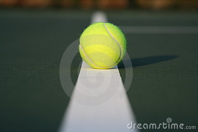 Tennis ball on court line