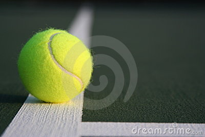Tennis ball on court line off center