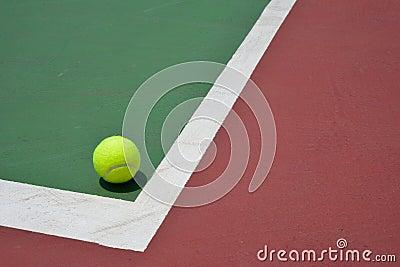Tennis ball on green court