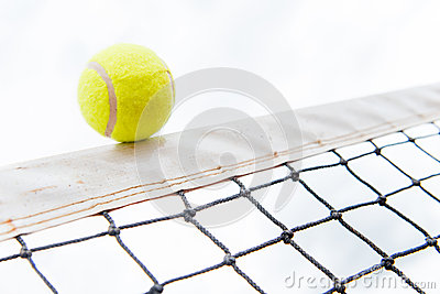 Tennis ball hiting the net