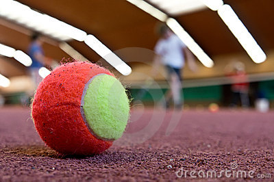 Tennis ball on indoor court