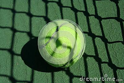 Tennis ball near net