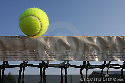 Tennis ball on the net