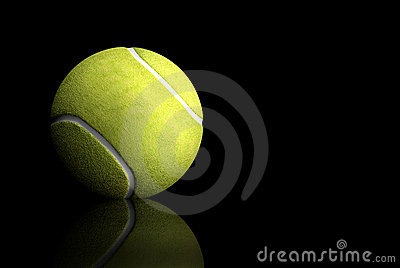 Tennis ball over black