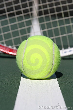Tennis ball with racquet background