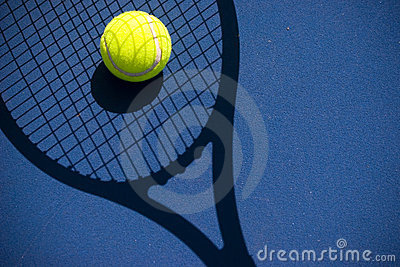 Tennis ball in a racquet shadow