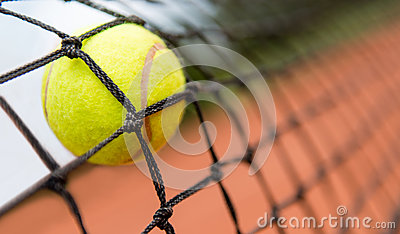 Tennis ball stuck on the net