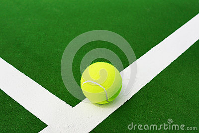 Tennis ball on white line