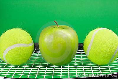 Tennis balls with apple and racket
