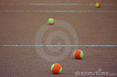 Tennis balls on clay court