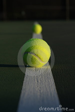 Tennis balls on the court line