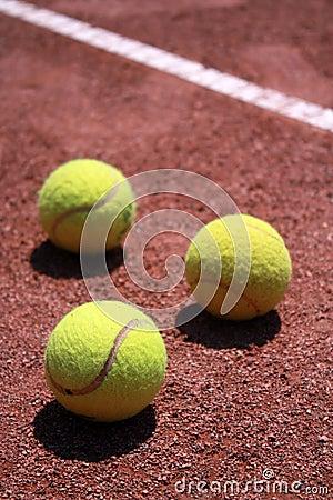 Tennis balls on slag field