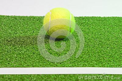 Tennis coconcept. Ball, line and grenn grass tennis court.horizo