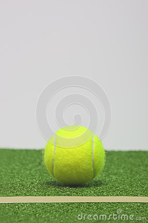 Tennis composition. Yellow ball, line and grenn grass tennis cou