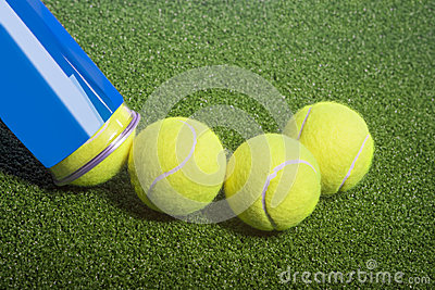 Tennis concept: tennis balls out of a container