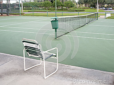 Tennis court and a chair