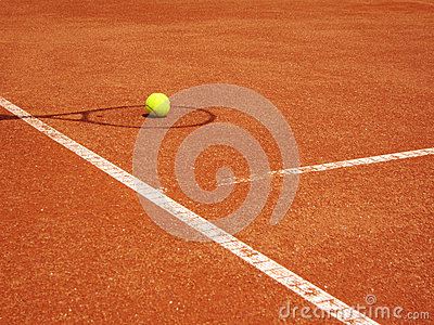 Tennis court and racket shadow with ball