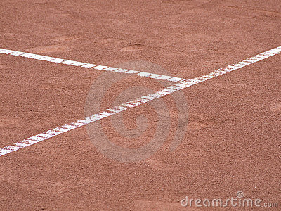 Tennis lines on terrain with footsteps