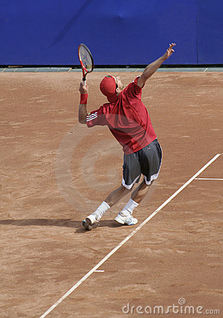 Tennis man serving