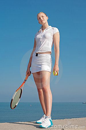 Tennis-player on background of the sky