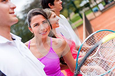 Tennis player with a group
