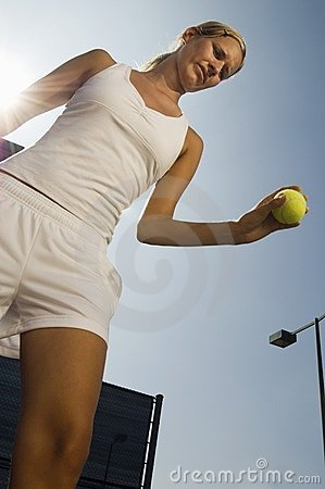 Tennis Player holding ball