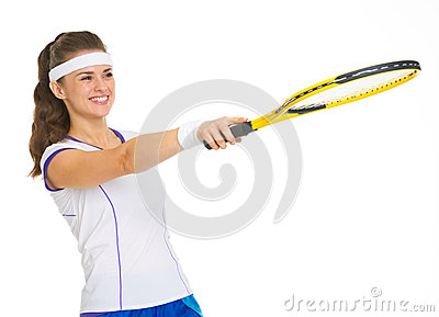 Tennis player pointing with racket on copy space