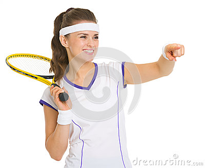 Tennis player with racket pointing on copy space