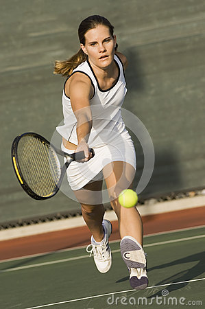 Tennis Player Reaching To Hit Ball